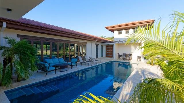 Bright home for sale a few steps to one of the most sought-after golf courses in Costa Rica...