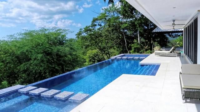 Less than 10 minutes from Tamarindo, modern home for sale with mountain views...