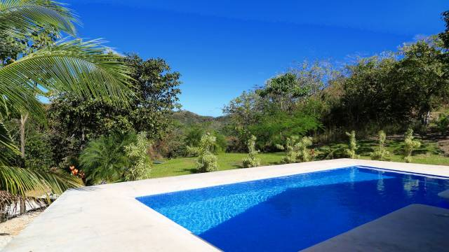 Three-bedroom home with a beautiful swimming pool for sale near Playa Grande...