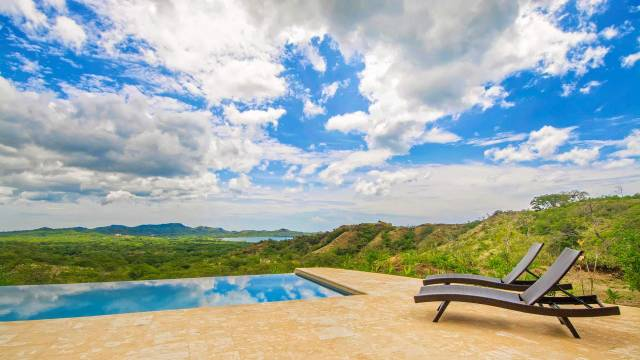 Bright home with ocean views for sale in the heights of Flamingo, northwest Costa Rica.