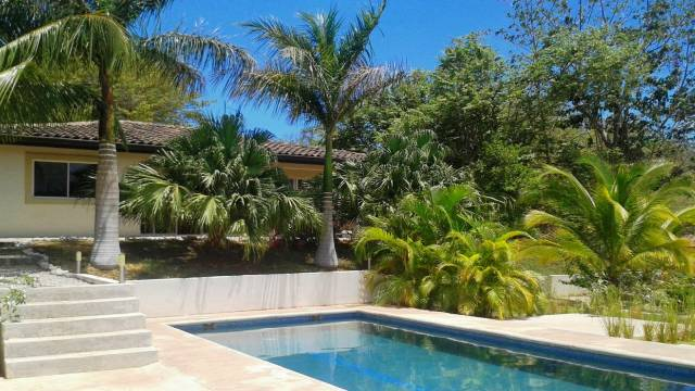 Property with several houses, two swimming pools and a building lot for sale close to Playa Grande…