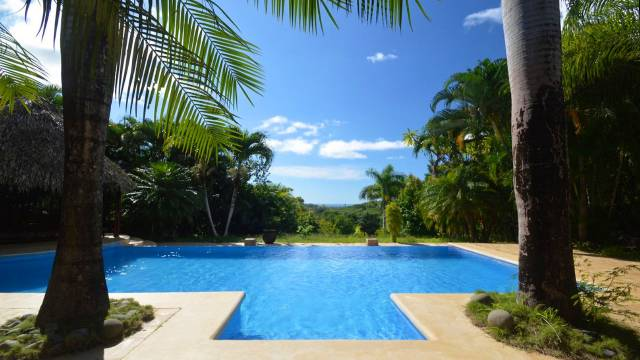 Ocean view home for sale in the sunniest place of Costa Rica, in the heart of an extensive 5.68-acre garden!