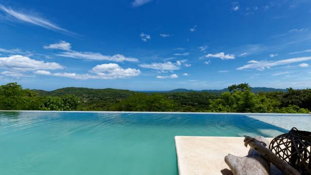 Two homes for sale in the beautiful Guanacaste region with expansive views of nature and the coastline...