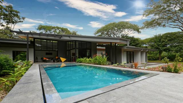 Near Tamarindo, architect designed home for sale on a very private tree-filled lot...